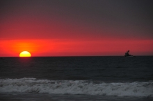 Sunset off the beach in Los Organos. On the northern coast of Peru.